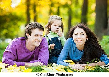 Happy family in autumn