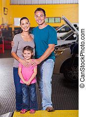 happy family in car service center