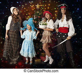 Happy family in carnival costumes