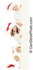 happy family in Christmas Santa's hats holding big banner for your advertisement isolated on white