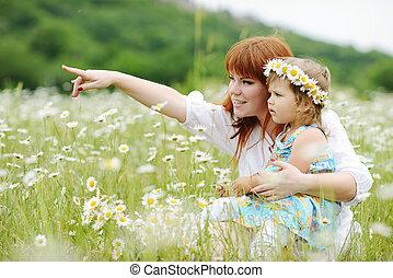 happy family in daisy field