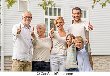 happy family in front of house outdoors