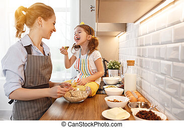 happy family in kitchen. mother and child baking cookies