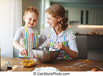 happy family in kitchen. mother and child preparing dough, ...