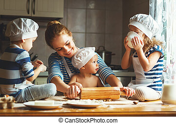 happy family in kitchen. mother and children preparing...