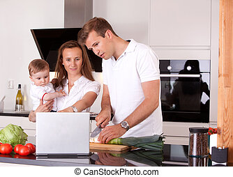 Family in Kitchen Preparing Meal