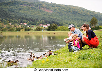 Happy family in nature in summer.