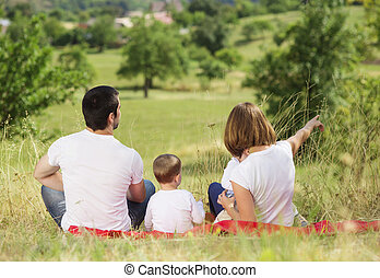 Happy family in nature