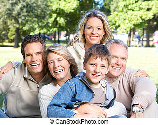 Happy family in park. Grandfather, grandmother, father,...