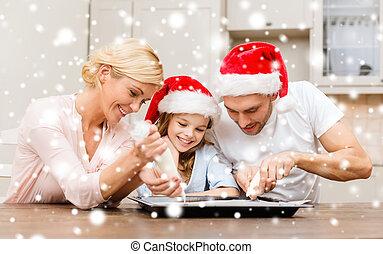 happy family in santa helper hats making cookies - food,...
