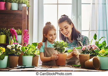 Happy family in spring day. - Cute child girl helps her...