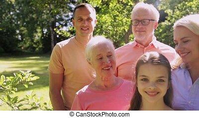 happy family in summer garden