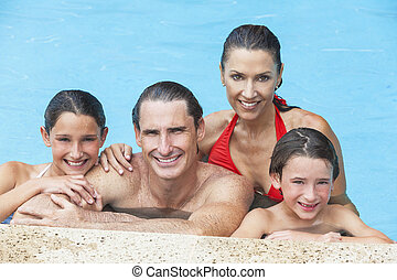 Happy Family In Swimming Pool