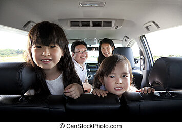 happy family in the car