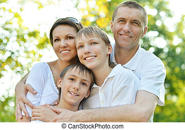 Happy family in the green