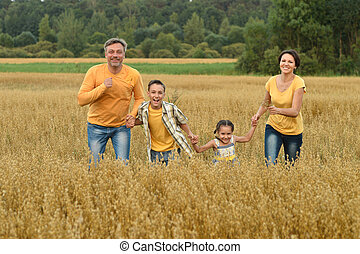 family in the green summer field
