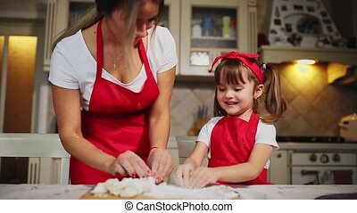 Happy family in the kitchen mom and daughter in the kitchen...