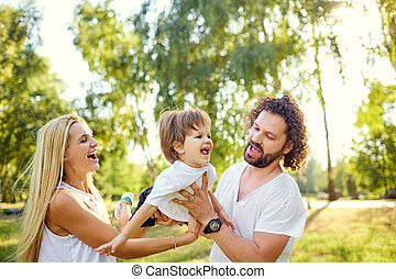 Happy family in the park.