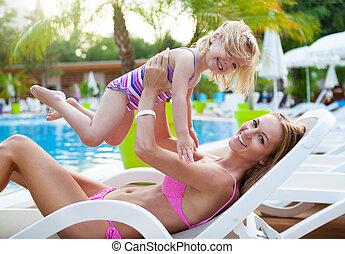 Happy family in the pool, having fun