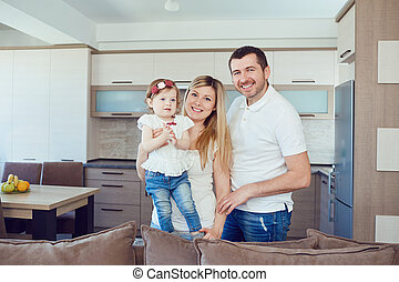 Happy family in the room.