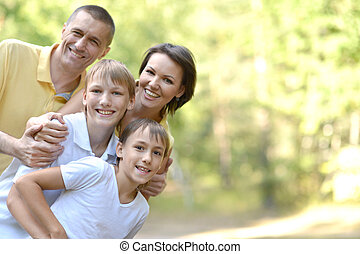 Happy family in the summer park