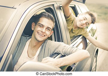 happy family in the travel car