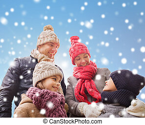happy family in winter clothes outdoors - family, childhood,...