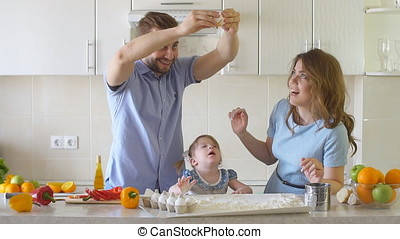 Happy Family is Cooking in The Kitchen. Daddy Breaks the Egg...
