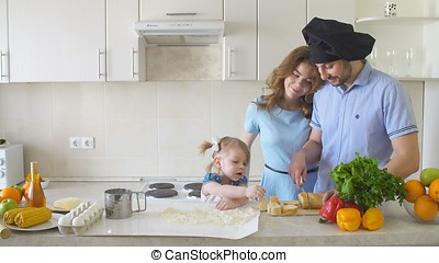 Happy Family is Cooking in The Kitchen