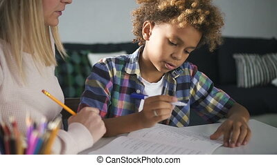 Happy family is doing homework at house with living room background.