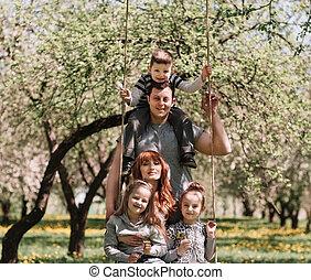 happy family is having fun in their garden.