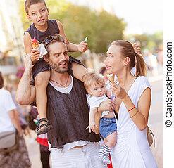 Happy family kids ice cream outdoors