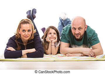 Happy family laying on floor
