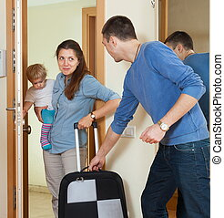 Happy family leaving the home