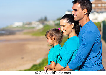 happy family looking at sea view