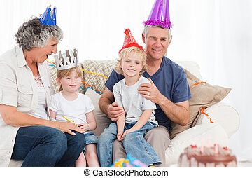 Happy family looking on a birthday