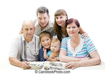 Happy family looking photo album