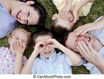 Happy family lying in the ground