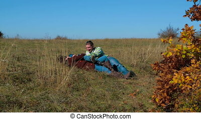 Happy Family Lying On Grass In Autumn Meadow