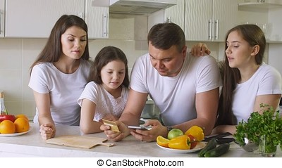 Happy Family Makes Purchases in Internet using a Credit Card.
