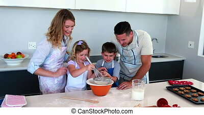 Happy family making a cake together