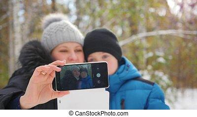 happy family making a selfie in winter Park