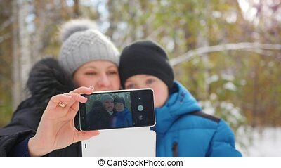 happy family making a selfie in winter Park