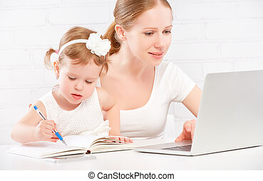 happy family mother and child baby at home working on ...