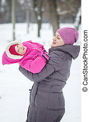 happy family mother and child daughter on a winter