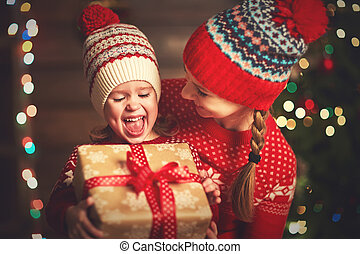 Happy family mother and child girl  with Christmas present