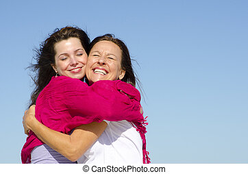 Happy family mother and daughter - Joyful cuddle of mother...