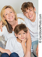 Happy Family Mother and Two Sons Children