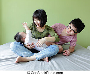 happy family, mother ,father and baby