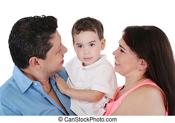 Happy Family: mother, father and son. Focus in the boy.